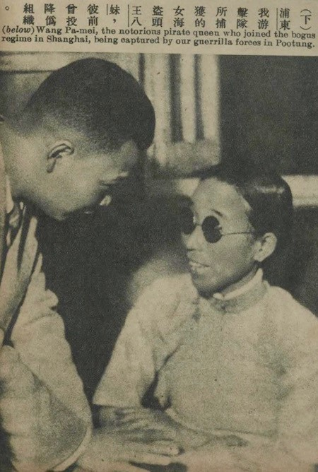 """Photo of Huang Bamei, the """"notorious pirate queen,"""" being captured by Chinese guerrilla forces. Source: """"Zhanzheng zhaopian"""" (1938, 10)."""